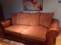Leather and designer fabric large sofa