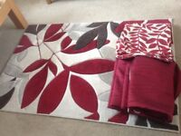 Fully lined red curtains, patterned rug and cushions