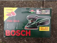 Bosch PSM 160A hand sander in original packaging with instructions