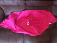 Bright pink Bugaboo hood