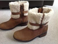 Ugg ladies tan leather boots. Sheepskin tops . Size 6 1/2. Like brand new.