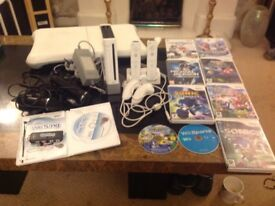 Wii console with board, games, we sing and 2x microphone, controllers,
