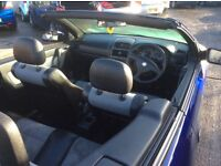 Astra convertible 2006 64k drives lovely half leather