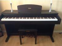 Yamaha digital piano and stool.