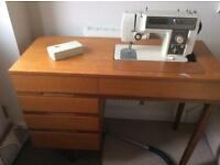 Toyota Sew Machine with motor, foot pedal and founding table.