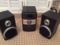 Phillips sound system iPod dock, radio, CD player. Two speakers.