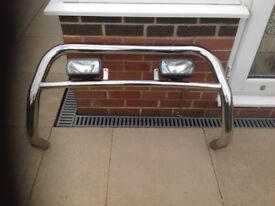 Chrome bull bar with two fog lights in very good condition.