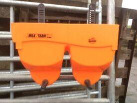 John Deere. Calves milk train
