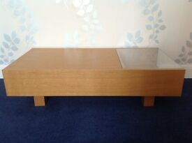 John Lewis wood coffee table with two end shelves, one with glass top, and hidden storage
