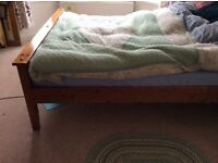 King size wooden bed frame for sale.