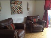 large leather sofa and 2 chairs