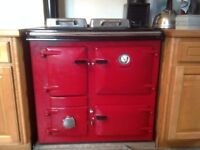 A Rayburn Royal Solid Fuel cooker in Claret for sale.