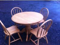 Solid pine round farmhouse style dining table and four chairs