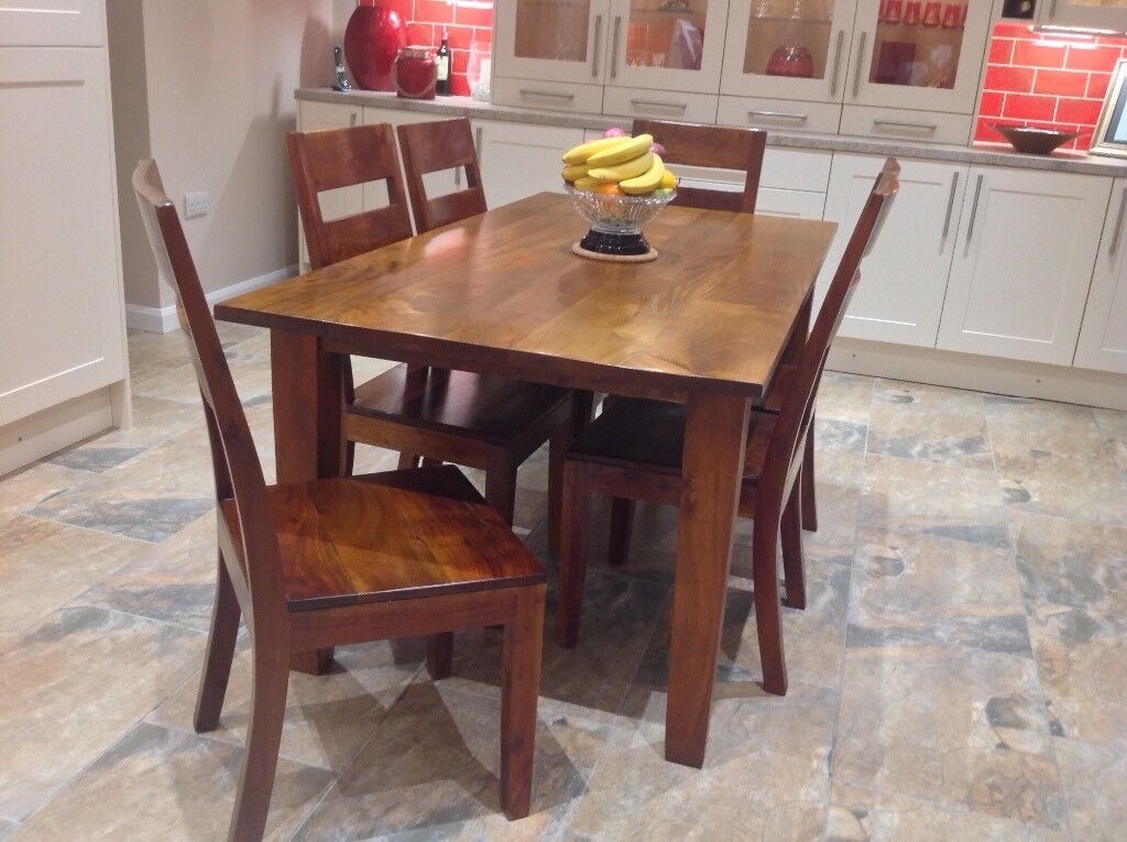 Dining table and 6 chairs and sideboard To match