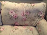 Two floral sofas
