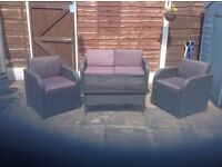 Rattan 3 piece suite of garden /patio furniture and glass topped coffee table