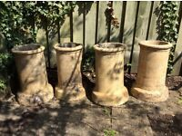 Four original chimney pots
