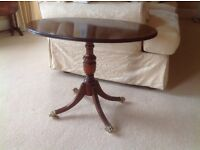 Pair of dark wood oval side tables