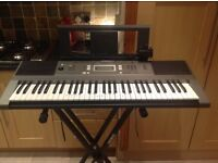 Yamaha electric keyboard and stand.