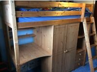 HIGHSLEEPER, SOLID PINE, WITH WARDROBE, 3 DRAWERS, DESK, AND 4 SHELVES UNDERNEATH.