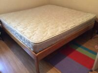 King size bed solid pine frame, and mattress.