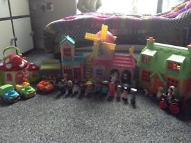 Mega bundle of Happyland good condition. Lots of people, vehicles and shops. Well loved