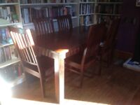 Dining room table + 6 chairs. Dark, solid wood.