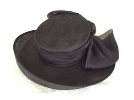 Black wide brimmed straw hat with bow