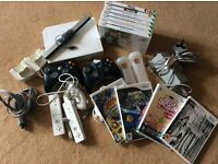 Wii console ,remotes and 11 games