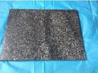 Black speckly granite worktop saver/ chopping board only used once very heavy!