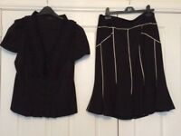 Coast black pleated blouse and black and white fishtail skirt