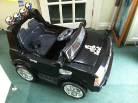 Range Rover style sit in childs electric car.
