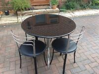 Black marble dining table and four chairs