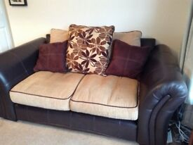 2 large brown leather and fabric sofas