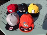 Baseball caps and snap backs. New Era, Crooks and Castle, Duvin and Baker Skateboards