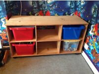Wooden unit with boxes for storage