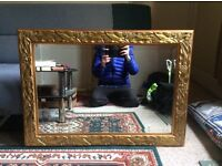 Ornate mirror with patterned gold border