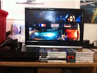 PS2 CONSOLE, 1 CONTROLLERS, MEMORY CARD AND 10 GAMES