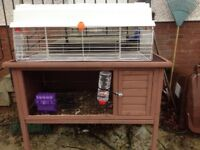 Two rabbit hutches for inside or outside use