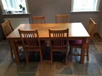 Oak dining table and 6 chairs. Rectangular shape.