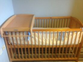 Baby/toddler adjustable base cot with mattress.