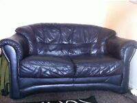 2 Black Leather Look Sofas & FREE Rug