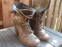 Women's dark grey, distressed style, healed boots.