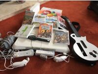 Wii game + 7games board and guitar