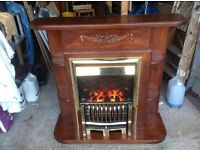 Bespoke fire surround with an electric coal effect fire.