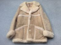 """BEAT THE BEAST OF THE EAST. Suede Sheep skin coat size 42"""" made by the company 'Baileys'."""