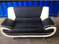 Two seater black and white leather sofa in good condition