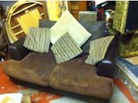 2 SEATER SETTEE ,FAUX LEATHER WITH FABRIC CUSHIONS