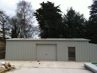 """Steel building - Man's """"Man Cave"""" large building with roll up door and side door entrance"""