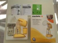Medela mini electric breast pump VGC + 16 freezing bags from Medela + Goodies!!